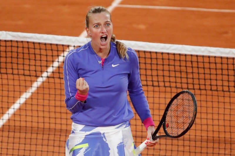 Kvitova lolos dari hadangan Fernandez