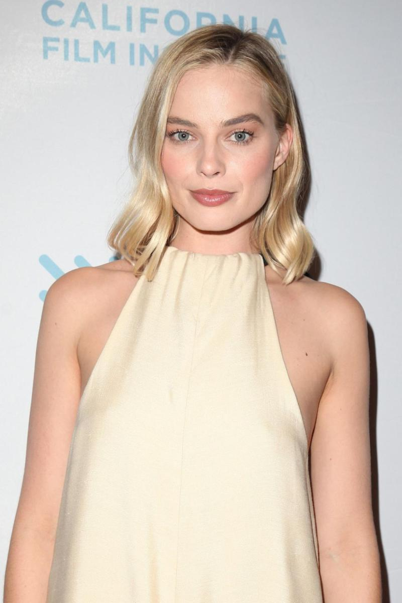 We're used to seeing Margot Robbie looking polished, here at the Film Institute premiere of I, Tonya. Source: Getty
