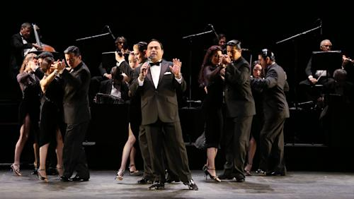 "In this July 11, 2013 photo released by The O + M Company, Gilberto Santa Rosa performs with ensemble cast of ""Forever Tango"" at the Walter Kerr Theatre on in New York. (AP Photo/The O + M Company, Walter McBride)"