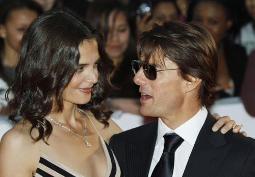 FILE - In this Wednesday, May 26, 2010 file photoTom Cruise, right, poses with his wife Katie Holmes pose for the photographers as they arrive for the National Movie Awards at the Royal Festival Hall, in London. Holmes' attorney Jonathan Wolfe said Friday June 29, 2012 that the couple is divorcing, but called it a private matter for the family. (AP Photo/Lefteris Pitarakis, File)