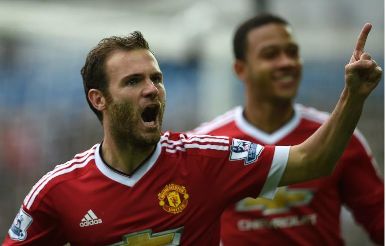 Manchester United's Juan Mata (L) celebrates after scoring during the Premier League match against Swansea City at The Liberty Stadium in Swansea on August 30, 2015