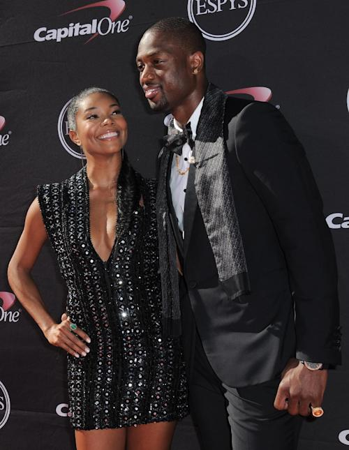 Actress Gabrielle Union, left, and Miami Heat's Dwyane Wade arrive at the ESPY Awards on Wednesday, July 17, 2013, at Nokia Theater in Los Angeles. (Photo by Jordan Strauss/Invision/AP)