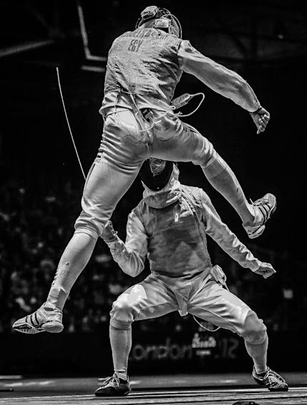 In this photo provided on Friday Feb. 15, 2013 by World Press Photo, the 2nd prize Sports – Sports Action Stories by Sergei Ilnitsky, Russia, for European Pressphoto Agency, shows Alaaeldin Abouelkassem of Egypt (top) in action against Peter Joppich of Germany (C) during their Men's Foil Individual Round16 match for the London 2012 Olympic Games in London, Britain, July 31, 2012. (AP Photo/Sergei Ilnitsky, European Pressphoto Agency)