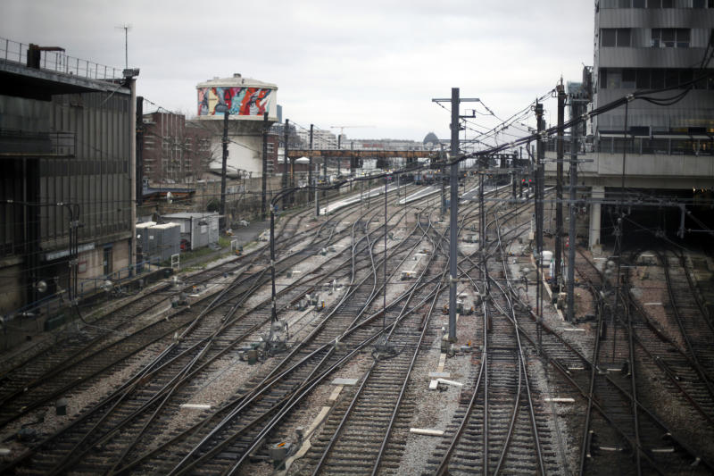 Empties railway tracks at the Gare d'Austerlitz railway station, in Paris, Friday, Dec. 27, 2019. France's punishing transportation troubles may ease up slightly over Christmas, but unions plan renewed strikes and protests in January to resist government plans to raise the retirement age to 64. (AP Photo/Thibault Camus)