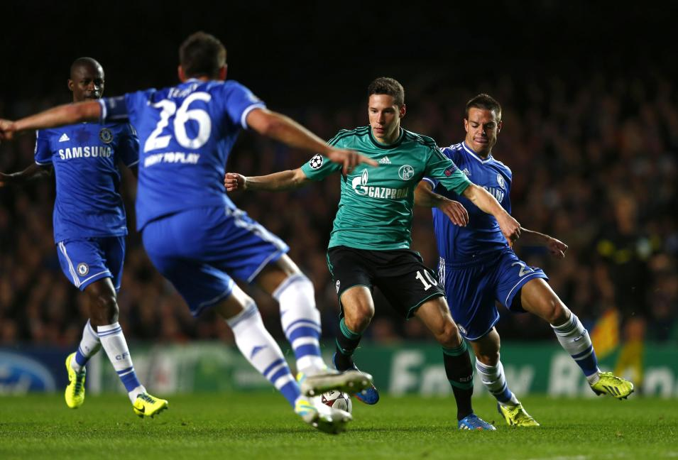FC Schalke 04's Draxler is surrounded by Chelsea players during their Champions League soccer match in London