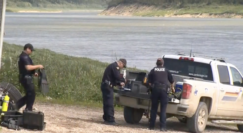 Police conducting a search at an area close to the Nelson River where a boat and items of interest were found on Friday. Source: Global News