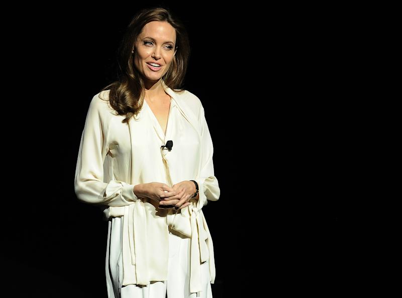 Angelina Jolie Surprises, '50 Shades' Smolders, And More From Universal's CinemaCon Panel