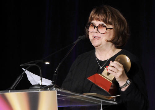 "FILE - In a Nov. 9, 2011, file photo Linda Ronstadt accepts the Life Time Achievement award at the Latin Recording Academy Lifetime Achievement Award and Trustees Award ceremony in Las Vegas. In an AARP Magazine article posted online Friday, Aug. 23, 2013, Ronstadt says that she was diagnosed with Parkinson's disease and ""can't sing a note."" (AP Photo/Chris Pizzello, file)"