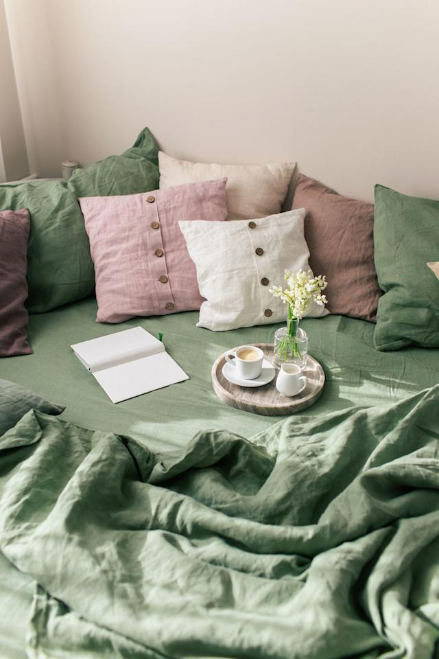 """<p>A mix of throw pillows makes guests feel like they just want to curl up on your couch with a good book. Kobi Karp, principal interior designer at <a href=""""https://www.kobikarp.com/"""" target=""""_blank"""">Kobi Karp Architecture & Interior Design</a>, says, """"Throw pillows or accent pillows are a quick and easy way to spice up your room with personality and charm. Fluff them, pile them or toss them; pillows have the power to transform the look and feel of any room."""" </p><p>The key here is to choose a <a href=""""https://burkelman.com/collections/pillows"""" target=""""_blank"""">bunch of different throw pillows</a> instead of just one kind. """"Mix sizes and colors on your couch. Never leave your couch with just two pillows. Make four as the minimum for maximum comfort,"""" advises Anne R. Kokoskie of <a href=""""http://www.styledbyark.com/"""">Styled by ARK</a>. And don't limit them to the couch, either. Kokoskie adds, """"Having oversized pillows stacked on the floor in family rooms or bedrooms also allows for flexibility in seating or lounging options.""""<br></p>"""