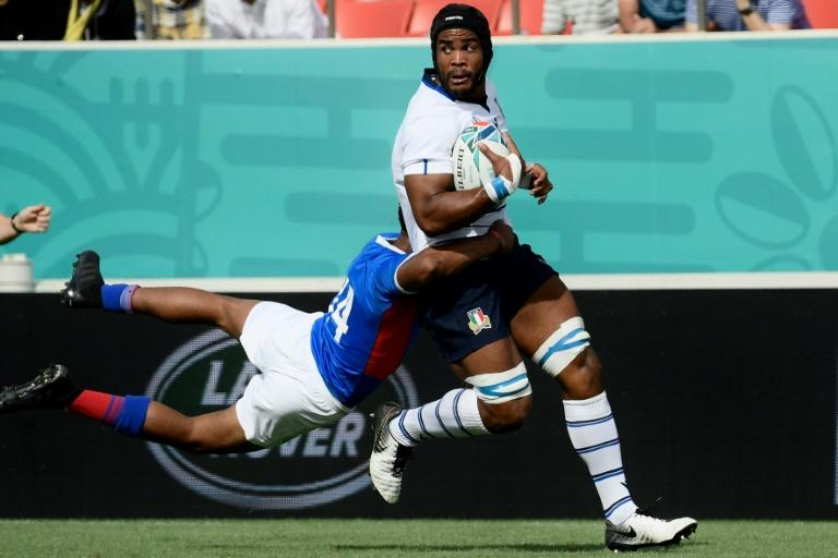 Maxime Mbanda, being tackled by Namibia's Chad Plato at the World Cup, is accustomed to a battle