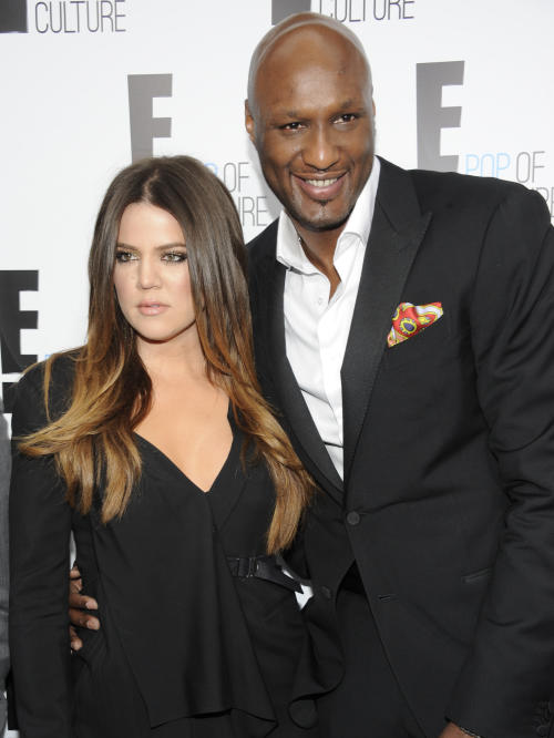 "FILE - In this April 30, 2012 file photo, Khloe Kardashian Odom and Lamar Odom pose at an E! Network event in New York. Odom is breaking his silence with his first post on Twitter since the NBA star was arrested and charged with driving under the influence last month. Odom tweeted ""Seeing the snakes"" on Tuesday night, Sept. 24, 2013, in his first post since his Aug. 30 arrest. (AP Photo/Evan Agostini, File)"
