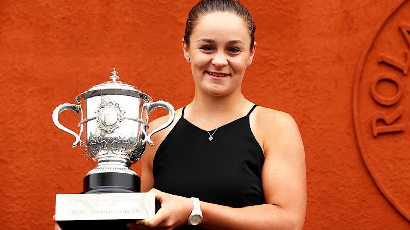 Ashleigh Barty, pictured here posing for a photo with the French Open trophy.