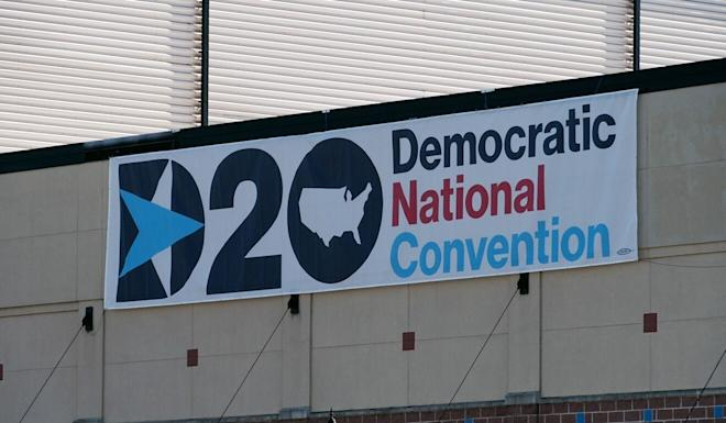 A banner on Tuesday in Wilmington, Delaware – near the home of Joe Biden, the Democratic presidential candidate – celebrates the party's nominating convention, which is being held virtually because of the pandemic. Photo: AFP