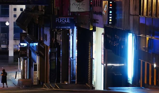 A lone figure at the deserted party zone of Lan Kwai Fong. Photo: Sam Tsang
