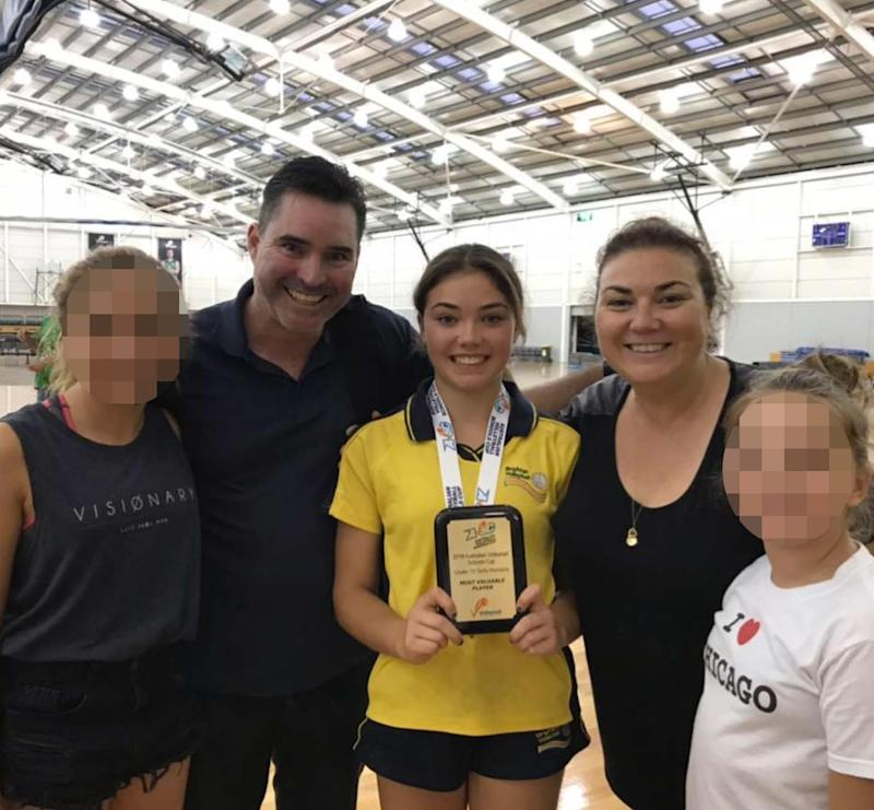 Sophia pictured with her parents, Luke Naismith and Pia Vogrin last year at a volleyball competition.