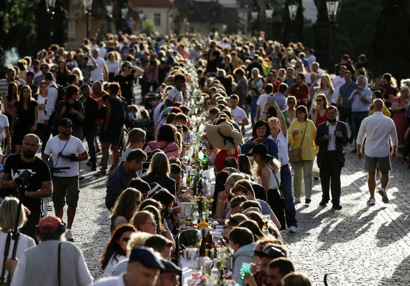 Residents dine at the medieval Charles Bridge in Prague