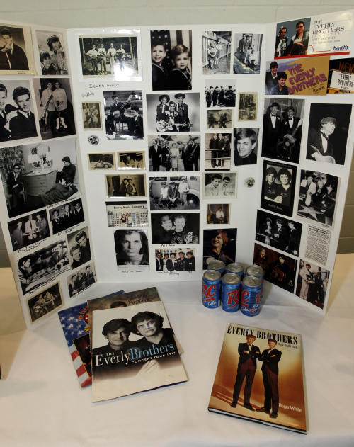 Everly Brothers fans could look over memorabilia and photos of The Everly Brothers before a memorial service for Phil Everly at the Merle Travis Music Center in Powderly, Kentucky, Saturday, Jan. 18, 2014. (AP Photo/John Sommers II)