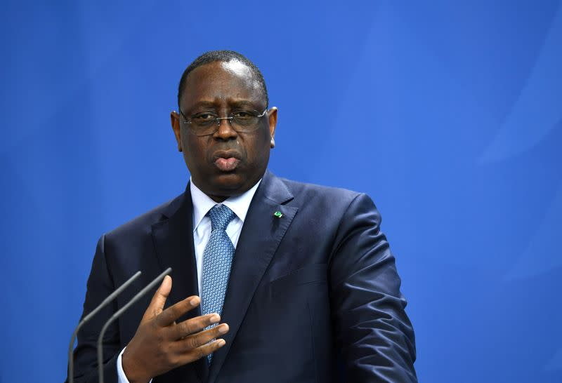 FILE PHOTO: German Chancellor Angela Merkel and Senegal's President Macky Sall hold a news conference in Berlin