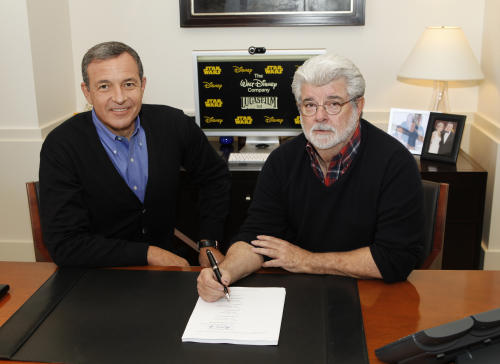 This image released by ABC shows Disney President and CEO Robert Iger, left, and filmmaker George Lucas of LucasFilm Ltd. at a contract signing in Burbank, Calif., Tuesday, Oct. 30, 2012. The Walt Disney Co. announced Tuesday that it was buying Lucasfilm Ltd. for $4.05 billion. (AP Photo/Disney, Rick Rowell)