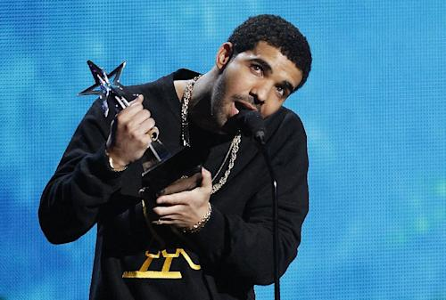 "FILE - In this June 26, 2011 file photo, Drake accepts the Coca-Cola Viewers' Choice Award for Rihanna's song ""What's My Name?"" featuring Drake at the BET Awards in Los Angeles. New York City police are investigating an early morning Manhattan bar brawl involving hip hop stars Drake and Chris Brown. Police say five people were injured in the fight at club W.I.P. early Thursday, June 14, 2012, where people from both entourages were tossing bottles. Police say the injuries were mostly minor lacerations.(AP Photo/Matt Sayles)"