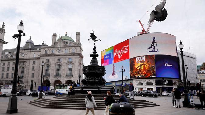 Pemandangan Piccadilly Circus di London, Inggris (18/3/2020). PM Inggris Boris Johnson pada Rabu (18/3) mengatakan seluruh sekolah akan ditutup mulai Jumat (20/3) setelah otoritas kesehatan mengonfirmasi total 2.626 kasus infeksi COVID-19 dan 104 kematian akibat penyakit tersebut. (Xinhua/Tim Irelan