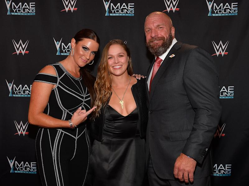 "WWE Chief Brand Officer Stephanie McMahon, Ronda Rousey and WWE Executive Vice President of Talent, Live Events and Creative Paul ""Triple H"" Levesque have worked closely on Rousey's wrestling career. (Photo by Bryan Steffy/Getty Images for WWE)"