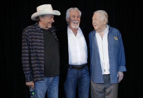 Bobby Bare, left, Kenny Rogers, and Jack Clement, right, pose for photographers on Wednesday, April 10, 2013, in Nashville, Tenn., after it was announced that they will be inducted into the Country Music Hall of Fame. (AP Photo/Mark Humphrey)