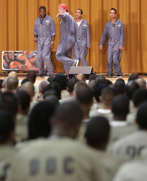 "In this Aug. 27, 2013, photo, inmates watch as rappers perform a hip hop adaptation of William Shakespeare's Othello, titled ""Othello: The Remix"" at the Cook County Jail in Chicago. The Q Brothers and Chicago Shakespeare Theater brought the the 70-minute adaptation of William Shakespeare's tragedy to perform for about 450 inmates. This Othello remix is the brainchild of two Chicago brothers and rappers - GQ and JQ, aka Gregory and Jefrrey Qaiyum - who wrote and directed the show, a 40-draft, eight-month project. (AP Photo/M. Spencer Green)"