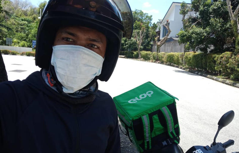 As a frontline worker during the shutdown, GrabFood rider Muhammad Asri Mohamad Ibrahim has been taking every precaution to stay clean. — Picture courtesy of GrabFood