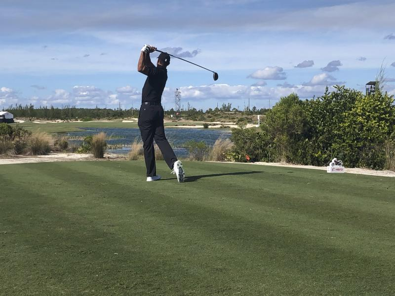 Tiger Woods tees off on the par-5 ninth at Albany Golf Club in the opening round of the Hero World Challenge on Wednesday, Dec. 4, 2019, in Nassau, Bahamas. Woods, the tournament host, shot 72 and was six shots off the lead. (AP Photo/Doug Ferguson)