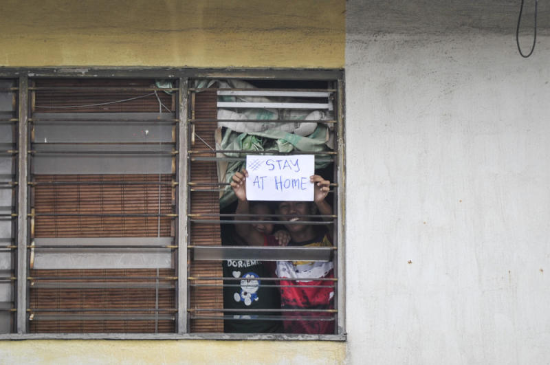 Petaling Jaya residents hold up a '#stayathome' sign during the movement control order March 22, 2020. — Picture by Shafwan Zaidon