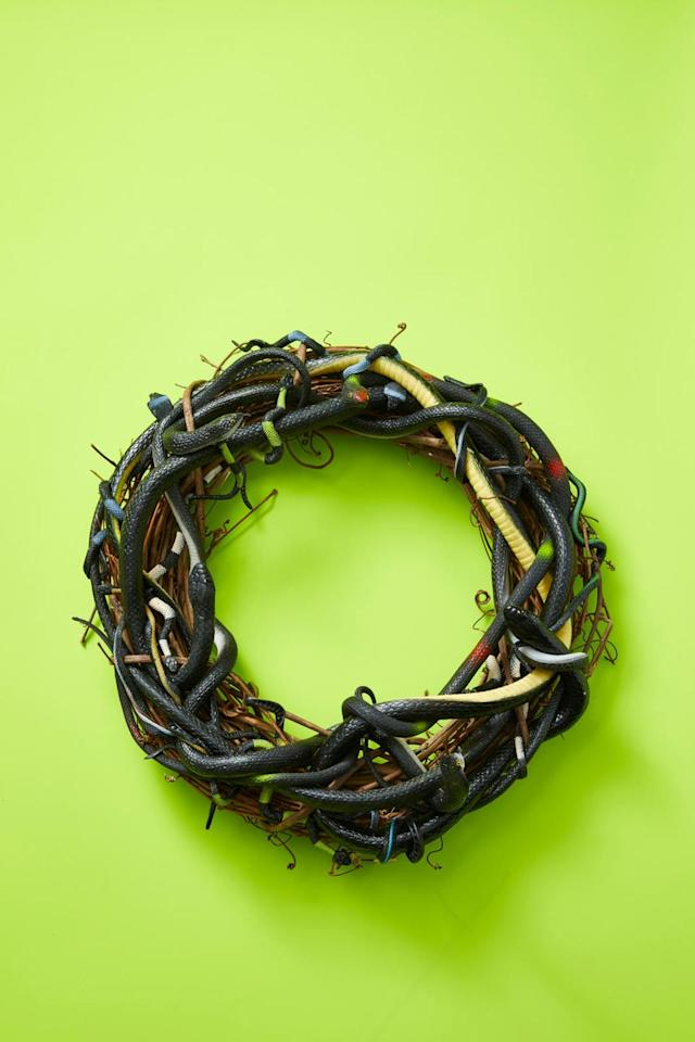 """<p>Spook the neighbors with this creepy, snake-laden wreath. To make it, gather an assortment of plastic snakes and a wreath form. Start with the largest snakes you have and weave them in between the twigs, repeating until you use all your rubber snakes. Use hot glue as needed to hold them to the wreath.</p><p><strong><a class=""""body-btn-link"""" href=""""https://www.amazon.com/dp/B075X3P38F/?tag=syn-yahoo-20&ascsubtag=%5Bartid%7C10055.g.4602%5Bsrc%7Cyahoo-us"""" target=""""_blank"""">SHOP GRAPEVINE WREATHS </a></strong></p><p><strong>RELATED:</strong> <a href=""""http://www.goodhousekeeping.com/holidays/halloween-ideas/g79/diy-halloween-wreaths/"""" target=""""_blank"""">22 Scary-Good Halloween Wreaths to Impress Trick-or-Treaters</a></p>"""