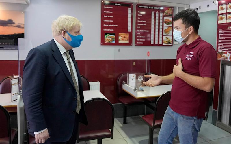 Boris Johnson speaks to shop ownes in Uxbridge - @BorisJohnson / Twitter