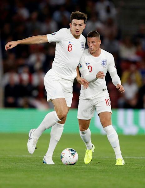 Harry Maguire (left) struggled for England against Kosovo