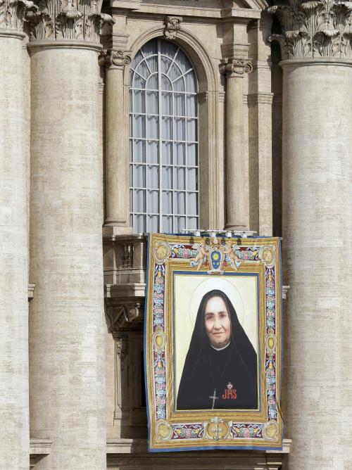 The tapestry of Maria Guadalupe Garcia Zavala of Mexico hangs from a balcony in St. Peter's Square at the Vatican prior to the start of the canonization ceremony led by Pope Francis Sunday, May 12, 2013. The pontiff will canonize, Laura di Santa Caterina da Siena Montoya of Colombia, Antonio Primaldo and his companions, also known as the Martyrs of Otranto, and Maria Guadalupe Garcia Zavala in a ceremony at the Vatican on Sunday. (AP Photo/Alessandra Tarantino)