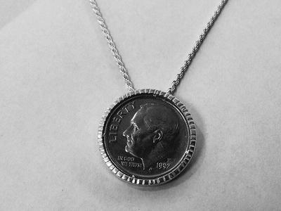 Personalized Coin Bezel Silver coin bezel with brass prongs.