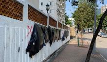 九龍塘有大廈外牆被人用紅油噴字 批評司法人員