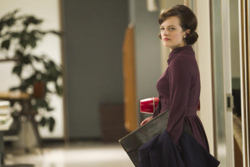 "In this publicity photo released by AMC, Elisabeth Moss as Peggy Olson is shown in Episode 11, Season 5, of ""Mad Men."" Moss was nominated for an Emmy award on Thursday, July 19, 2012 for outstanding actress in a drama series for her role as Peggy Olson. The 64th annual Primetime Emmy Awards will be presented Sept. 23 at the Nokia Theatre in Los Angeles, hosted by Jimmy Kimmel and airing live on ABC. (AP Photo/AMC, Jordin Althaus)"