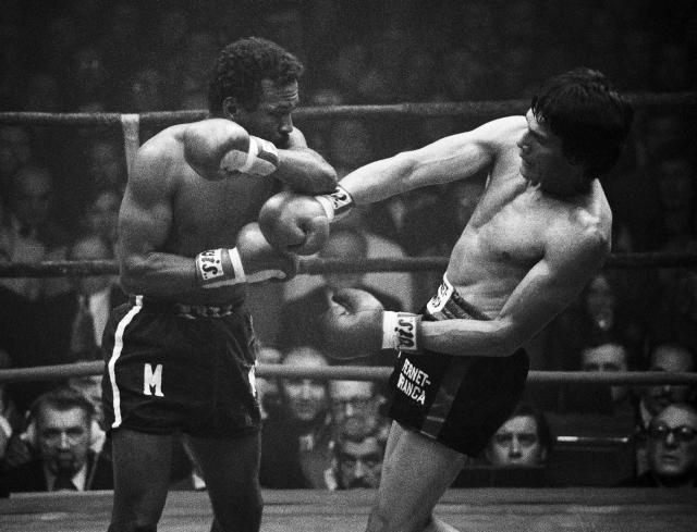 Titleholder Carlos Monzón of Argentina, right, uses his long reach to land a left to Jose Napoles of Mexico in their World Middleweight Championship, Feb. 9, 1974, Paris, France. Monzón battered World Welterweight Champion Napoles who failed to come out at the bell for the 7th round. (AP Photo/Michel Lipchitz)