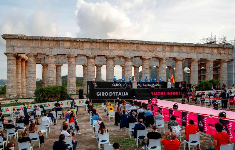 Socially distanced spectators attend the presentation of the Movistar Team Rear on stage at the Doric Temple of Segesta near Palermo Sicily on October 1 2020 during an opening ceremony of presentation of participating teams and riders two days ahead of the departure of the Giro dItalia 2020 cycling race Photo by Luca Bettini AFP Photo by LUCA BETTINIAFP via Getty Images