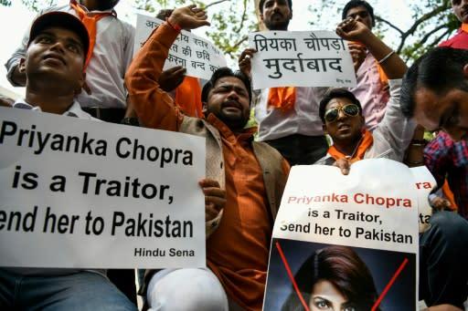 Members of a fringe Hindu nationalist group protest against Chopra
