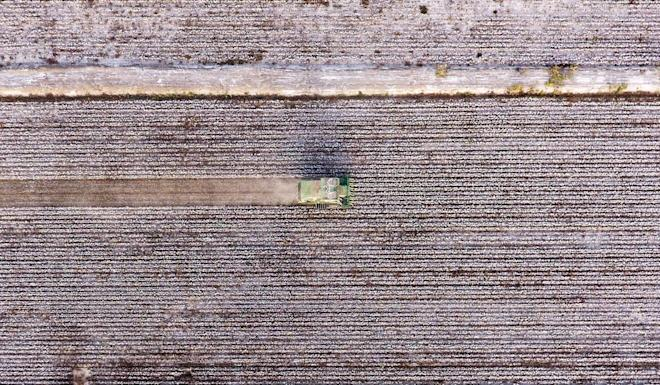 An aerial photo taken in October last year shows a harvesting machine picking cotton in a field in Awat county, northwest China's Xinjiang Uygur autonomous region. Photo: Xinhua/Sadat