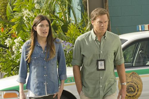 "This undated publicity image released by Showtime showsJennifer Carpenter as Debra Morgan, left, and Michael C. Hall as Dexter Morgan in a scene from the final season of ""Dexter,"" airing Sundays at 9 p.m. EST on Showtime. (AP Photo/Showtime, Randy Tepper)"