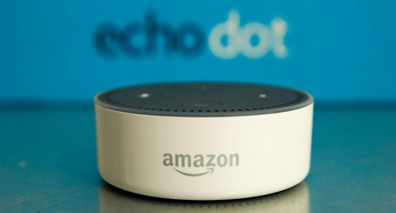 "The Amazon ""Echo Dot"" device sits during the U.K. launch event for the Amazon Echo voice-controlled home assistant speaker."