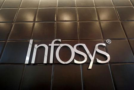 FILE PHOTO - The logo of Infosys is pictured inside the company's headquarters in Bengaluru