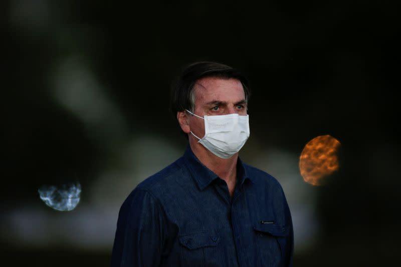 Brazil's Bolsonaro, infected with COVID-19, touts unproven drug