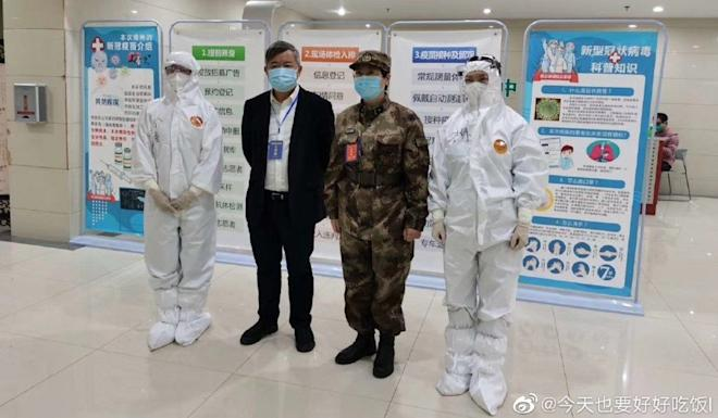 Major general Chen Wei (second right) is leading the trial in Wuhan and was the first person to be given a shot. Photo: Weibo