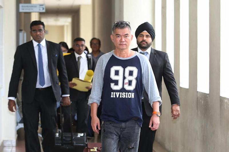 Koh Tat Meng (right) arrives at the Petaling Jaya Magistrate's Court with his lawyer Rajesh Nagarajan (left), October 18, 2019. ― Picture by Choo Choy May
