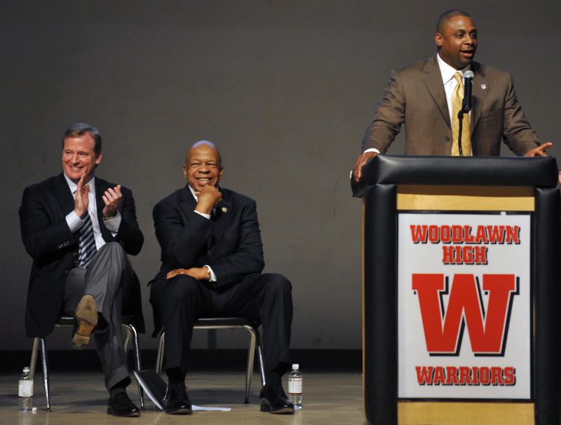 NFL Vice President and former NFL player Troy Vincent speaks while Roger Goodell and Elijah Cummings look on.