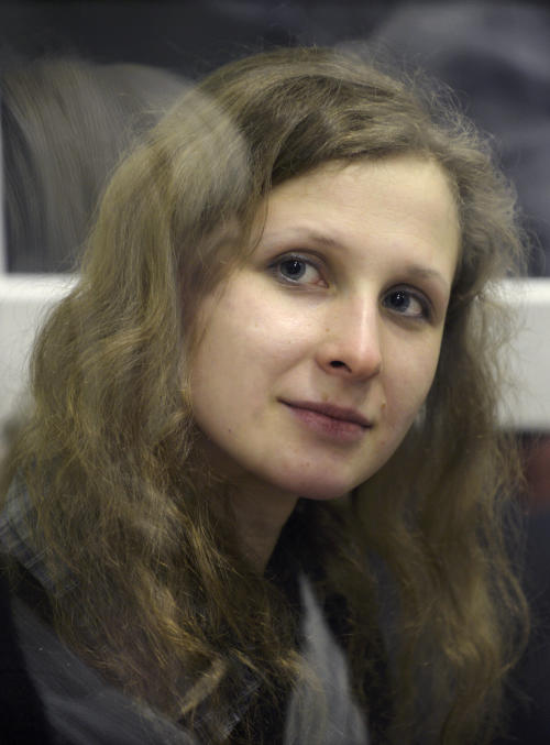 FILE - In this Wednesday, Jan. 16, 2013 file photo, jailed feminist punk band Pussy Riot member Maria Alekhina is in a defendant's cage in a court room in the town of Berezniki, some 1500 km (940 miles) north-east of Moscow, Russia. The imprisoned member of the punk band Pussy Riot is going on hunger strike on Wednesday, May 22, 2013, after a judge refused to allow her to attend a court hearing. Alekhina was convicted of hooliganism motivated by religious hatred, last year, along with two other Pussy Riot band members for an anti-President Vladimir Putin stunt in Russia's main cathedral. (AP Photo/Alexander Agafonov, file)